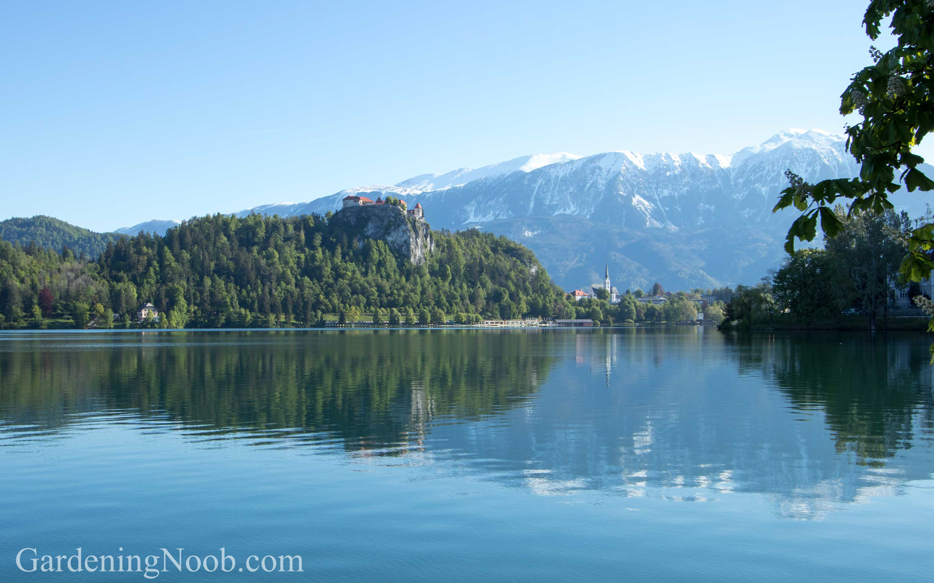 Snow covered mountain peaks in May in Bled, Slovenia.